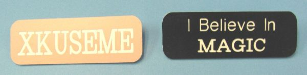 I Believe in Magic and XKUSEME Pin Back Badges