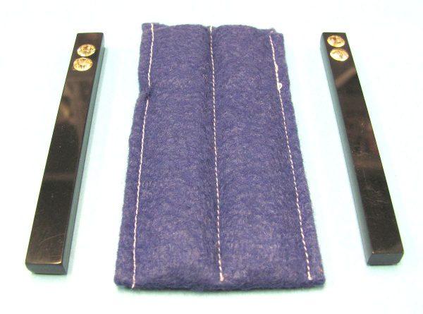 Two Black Paddle Sticks With Blue Felt Holder